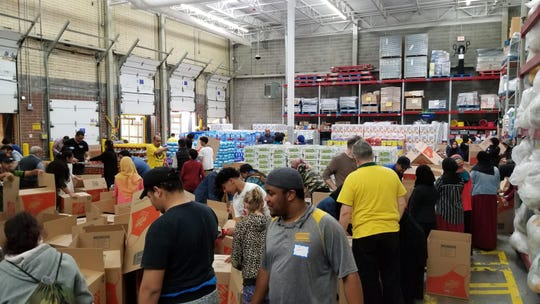 Volunteers gathered Saturday in Wixom to package more than 1,100 boxes of food for low-income families in Metro Detroit.