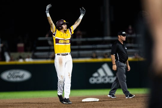 Central Michigan's Evan Kratt celebrates his three-run double in the fifth inning on Friday.