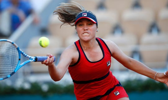 Sofia Kenin of the U.S. plays a shot in her third round match against Serena Williams.
