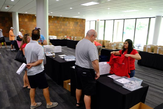 Thousands of volunteers picked up their uniforms for the Rocket Mortgage Classic.