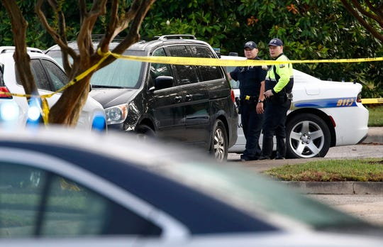 The gunman who attacked his colleagues at a Virginia Beach government office building resigned by email hours before the shooting, a city official said Sunday as authorities sought a motive in the assault that killed 12 people.
