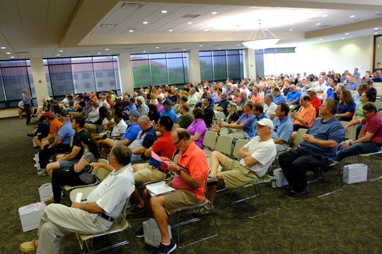 Thousands of golf fans gather at the University of Detroit Mercy for training and to collect their uniforms ahead of the PGA Tour tournament at Detroit Golf Club.