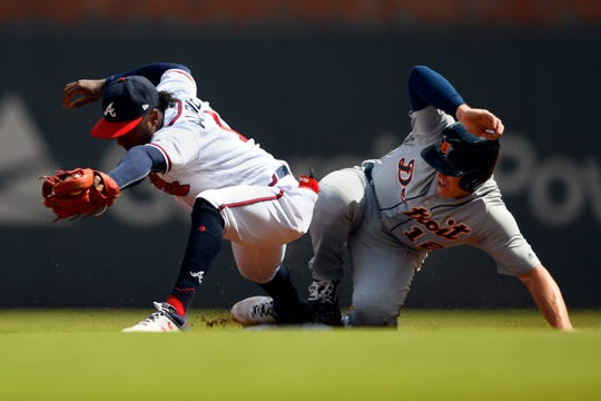 Atlanta Braves second baseman Ozzie Albies forces out Detroit Tigers' Brandon Dixon, right, on a ground ball by John Hicks to shortstop Dansby Swanson during the first inning.