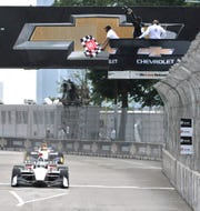 Team Penske driver Josef Newgarden staves off Alexander Rossi to win the time-limited Chevrolet Dual in Detroit - Dual 1.