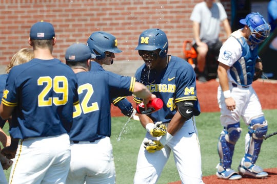 Michigan's Jordan Nwogu (42) celebrates his solo home run in the fifth inning against Creighton on Friday.