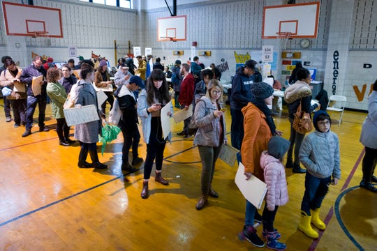 In this Tuesday, Nov. 6, 2018, file photo, voters stand in line to cast their ballots at P.S. 22, in the Prospect Heights neighborhood in the Brooklyn borough of New York.