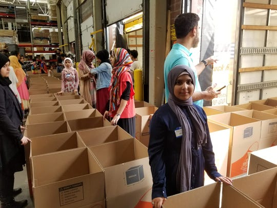 Ruqaya Khan, one of the youngest volunteers at age 10, from Oakland International Academy charter Middle school in Detroit. She says her first time participating made her feel good to help people who need food.