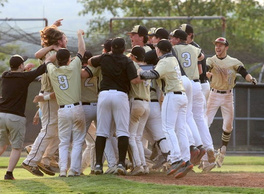 Corning players celebrate after getting the final out in a deciding 5-4 Game 3 win over Ithaca in the Section 4 Class AA baseball finals May 31, 2019 at Ithaca College.