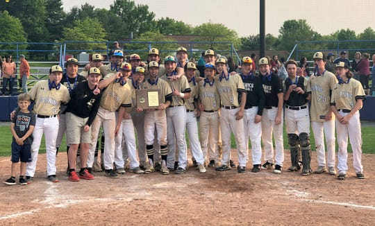 Corning players pose with their championship plaque after winning the Section 4 Class AA baseball title with a 5-4 win over Ithaca in a deciding Game 3 on May 31, 2019 at Ithaca College.