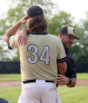 Corning head coach Eric Kizis hugs his son, Tanner Kizis (34), after the Hawks 5-4 win over Ithaca in a deciding Game 3 of the Section 4 Class AA baseball finals May 31, 2019 at Ithaca College.