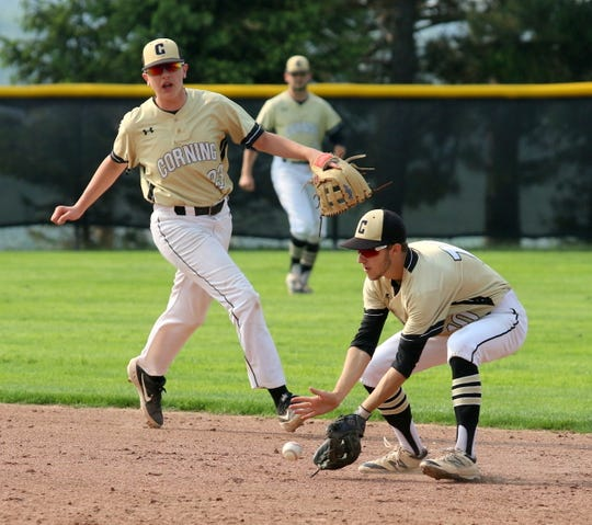 Corning second baseman Noah Walker fields a ground ball in front of shortstop Landen Burch during the Hawks' 5-4 win in Game 3 of the Section 4 Class AA baseball finals May 31, 2019 at Ithaca College.