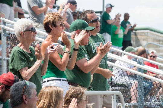 Vincennes Lincoln fans cheer from the stands during the 3A regional baseball game against Memorial earlier this month.