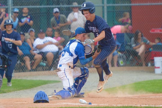 Resurrection Christian catcher Jared Whitaker tags out a runner at home during the 3A title game against University at Butch Butler Field in Greeley on Saturday, June 1, 2019. University won 10-3.