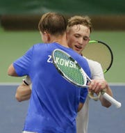 De Pere's Nathan Balthazor congratulates Green Bay Southwest's Johnny Zakowski after Zakowski takes the Division 1 singles championship Saturday at the WIAA boys tennis state tournament at Nielsen Tennis Stadium  in Madison.