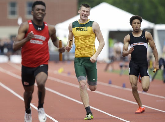 Green Bay Preble's Jack Dessart races to the finish line of the Division 1 800-meter relay during the WIAA state track and field meet on Saturday,