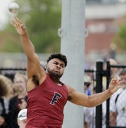 Fond du Lac's Andrew Stone throws in the Division 1 shot put competition at the WIAA state track and field meet Saturday at Veterans Memorial Field in La Crosse.