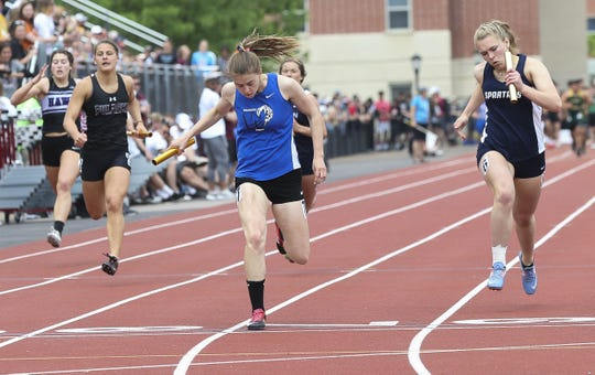 Oshkosh West High School's Devin Hable crosses the finish line of the Division 1 800-meter relay during the WIAA state track and field meet on Saturday, June 1, 2019, at Veterans Memorial Stadium in La Crosse, Wis.