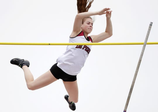 De Pere's Olivia Fabry clears the bar during the Division 1 pole vault at the WIAA state track and field meet Saturday at Veterans Memorial Field Sports Complex in La Crosse.