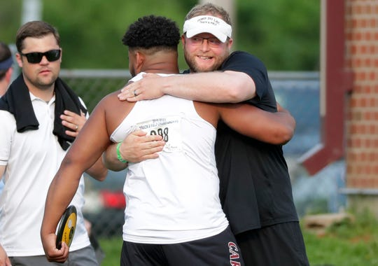 Fond du Lac's Andrew Stone hugs throwing coach TJ Severson after winning the Division 1 discus throw Friday at the WIAA state track and field meet.