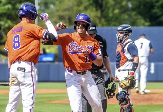 Clemson's Michael Green (11) is congratulated by teammate Logan Davidson (8) after hitting a home run against Illinois at the NCAA college baseball regional tournament, Friday, May 31, 2019, in Oxford, Miss. (Bruce Newman/The Oxford Eagle via AP)