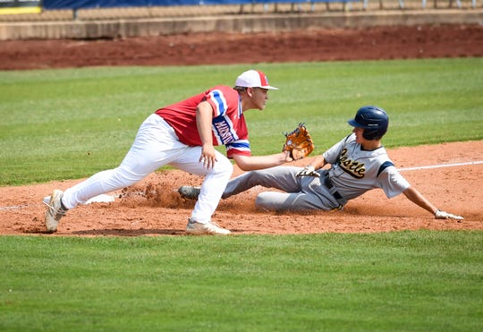 Castle's Caleb Niehaus (6) beats the tag at third as Martinsville's Braxton Wright (21) waits for the ball in the second inning of the Knights' 8-2 win in the Class 4A regional semis Saturday at Bosse Field.
