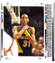 """Indiana Pacers guard Reggie Miller clutches at his neck signifying that the New York Knicks """"choked"""" in the fourth quarter of Eastern Conference finals on June 1, 1994, at Madison Square Garden."""