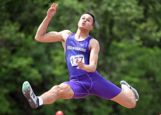 Brownsburg's Pierce Thomas competes in the long jump during the boys IHSAA track and field state finals at Robert C. Haugh Track and Field complex in Bloomington, Ind. on Friday, May 31, 2019.