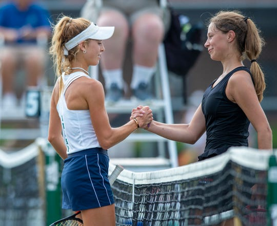 Cathedral High School number one singles player senior Ellie Pittman, left, and Park Tudor High School number one singles player freshman Lauren Long meet at the net after their game during the 45th Annual Girls' Tennis Team State Finals, Saturday, June 1, 2019, at North Central High School in Indianapolis.