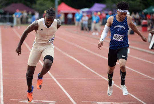 Warren Central's Jordan Hodge defeats Hamilton Northeastern's Noah Malone in the 100 meter dash final during the boys IHSAA track and field state finals at Robert C. Haugh Track and Field complex in Bloomington, Ind. on Friday, May 31, 2019.