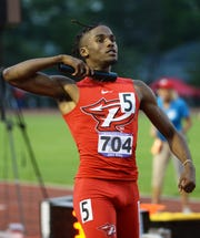Pike's Jahn Riley celebrates after anchoring Pike to a win in the 4x400 meter relay during the boys IHSAA track and field state finals at Robert C. Haugh Track and Field complex in Bloomington, Ind. on Friday, May 31, 2019.