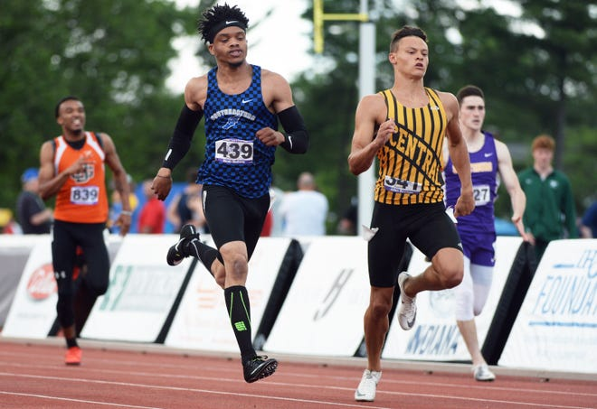 Hamilton Southeastern's Noah Malone and Evansville Central's Jalen Bowman run in the 100 meter dash preliminaries during the boys IHSAA track and field state finals at Robert C. Haugh Track and Field complex in Bloomington, Ind. on Friday, May 31, 2019.