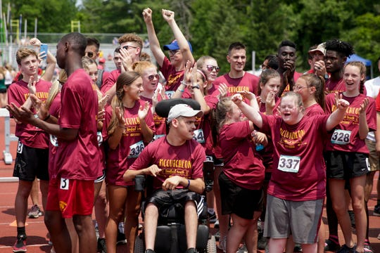 The McCutcheon Unified Track & Field team reacts after placing fourth in the State Finals, Saturday, June 1, 2019, at Indiana University's Robert C. Haugh Track & Field Complex in Bloomington.