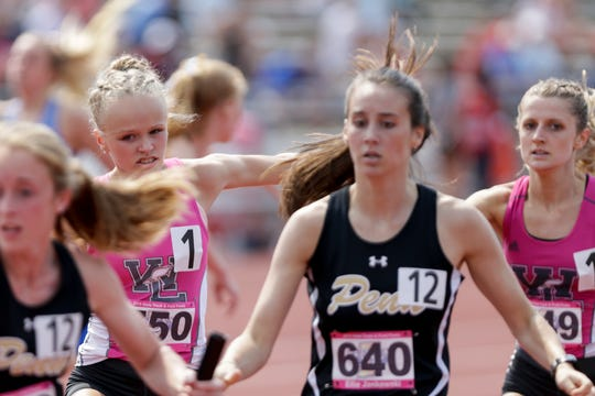 West Lafayette's Mary Schultz hands the baton to Alli Steffey as they compete in the 4x800 meter relay during the IHSAA Girls Track & Field State Finals, Saturday, June 1, 2019, at Indiana University's Robert C. Haugh Track & Field Complex in Bloomington.