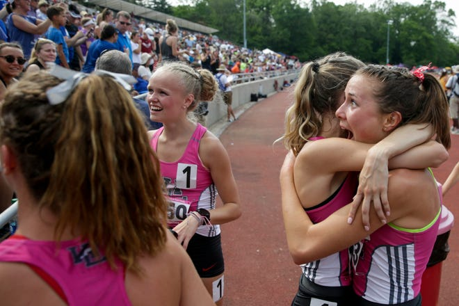 West Lafayette's Mary Schultz, left, embraces Emma Tate after winning the 4x800 meter relay during the IHSAA Girls Track & Field State Finals, Saturday, June 1, 2019, at Indiana University's Robert C. Haugh Track & Field Complex in Bloomington.