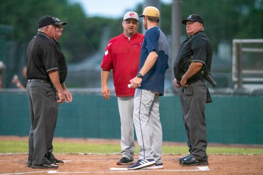 Cane Cutters coach Ricky VanAsselberg speaks with umpires before Friday's game against Brazos Valley at Fabacher Field.