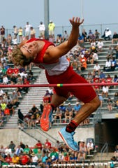 Shelby's Uriah Schwemley clears the bar in the Division II boys high jump Saturday, June 1, 2019, at the state track and field meet at Jesse Owens Stadium in Columbus.