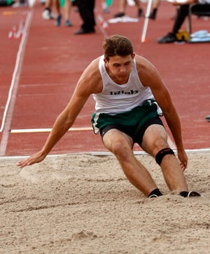 Fisher Catholic's Daniel Turner lands in the sand pit during the finals of the Division III boys long jump Friday, May 31, 2019, during the state track and field meet at Jesse Owens Memorial Stadium in Columbus.