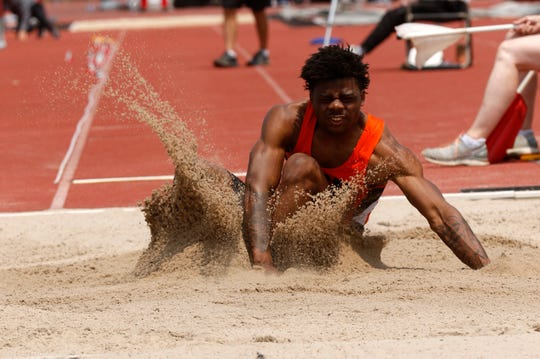 Sand flies up around Mansfied's Angelo Grose during the Division I boys long jump Saturday, June 1, 2019, at the state track and field meet at Jesse Owens Stadium in Columbus.