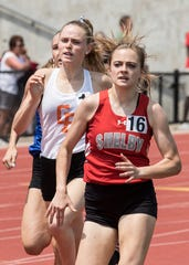 Shelby's Makenna Heimlich competes in the 800 meter run en route to a third place medal in the state track meet.