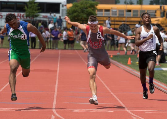 Jacob Rhodes competes in the boys 200-meter dash during a Division II state final on Saturday, June 1, 2019, at the Jesse Owens Memorial Stadium in Columbus, Ohio.
