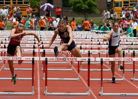 Galion's Kerrigan Myers dethrones Perry's two-time defending champ Leah King (far left) for a state title in the Division II 100 hurdles.