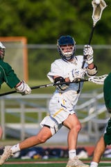 Hartland's Reece Potter had three goals and three assists in a 12-11 state quarterfinal lacrosse loss to Lake Orion on Friday, May 31, 2019.