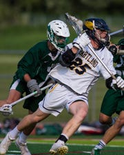 Hartland's Brandon Plemmons moves the ball in a 12-11 loss to Lake Orion in the state lacrosse quarterfinals at Linden on Friday, May 31, 2019.