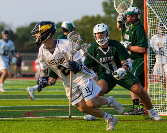 Bo Lockwood (2) had a goal and five assists for Hartland in a 12-11 loss to Lake Orion in the state quarterfinals at Linden on Friday, May 31, 2019.