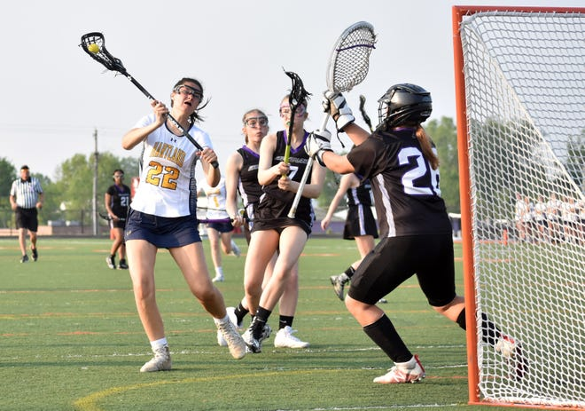 Elena Salazar (22) scored nine goals for Hartland in a 17-10 victory over Walled Lake Central in a regional championship lacrosse game at Fenton on Friday, May 31, 2019.