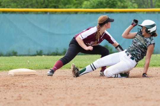 Howell's AJ Militello slides into second base in a district semifinal softball game against Dexter that has been scheduled to conclude at 4:30 p.m. Monday at Ann Arbor Skyline.