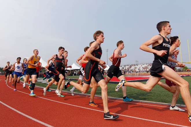 Runners compete in the 3200 meter run, Saturday, June 1, 2019, at East Kentwood High School in Kentwood, Mich.