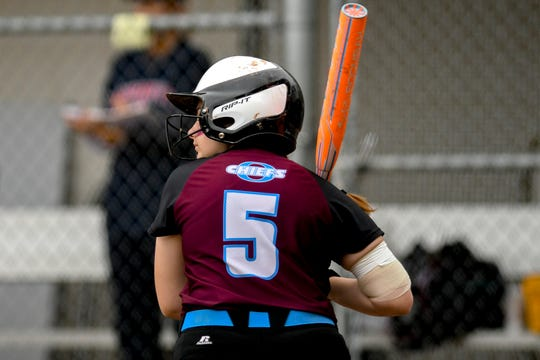 Okemos' Johana Rieck steps up to the plate before getting a hit in the first inning on Saturday, June 01, 2019, in East Lansing.