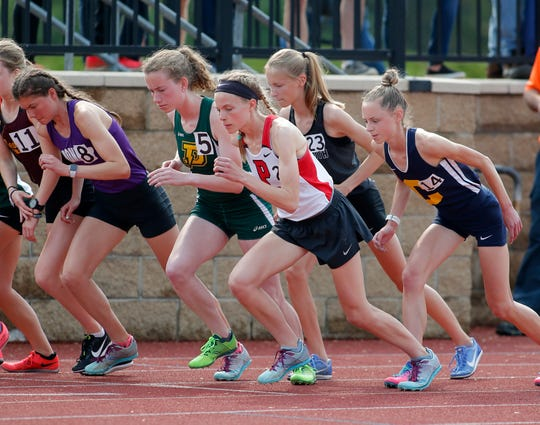 Pinckney's Noelle Adriaens, center, begins the 3200 meter run, Saturday, June 1, 2019, at East Kentwood High School in Kentwood, Mich.