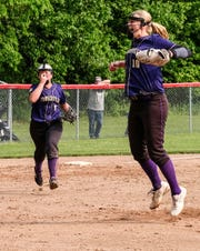 Fowlerville pitcher Leah Ash (10) celebrates after striking out the last batter in the Girls District Championship game beating Mason 4-3 Saturday, June 1, 2019.